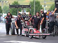 Jun 21, 2015; Bristol, TN, USA; Crew members push NHRA top fuel driver J.R. Todd forward towards the water box during the Thunder Valley Nationals at Bristol Dragway. Mandatory Credit: Mark J. Rebilas-