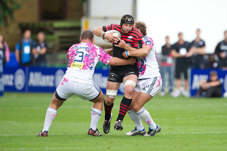 20120823 Copyright onEdition 2012©.Free for editorial use image, please credit: onEdition..Steve Borthwick of Saracens is tackled by Blaise Dumas and Arthur Chollon of Stade Francais Paris at The Honourable Artillery Company, London in the pre-season friendly between Saracens and Stade Francais Paris...For press contacts contact: Sam Feasey at brandRapport on M: +44 (0)7717 757114 E: SFeasey@brand-rapport.com..If you require a higher resolution image or you have any other onEdition photographic enquiries, please contact onEdition on 0845 900 2 900 or email info@onEdition.com.This image is copyright the onEdition 2012©..This image has been supplied by onEdition and must be credited onEdition. The author is asserting his full Moral rights in relation to the publication of this image. Rights for onward transmission of any image or file is not granted or implied. Changing or deleting Copyright information is illegal as specified in the Copyright, Design and Patents Act 1988. If you are in any way unsure of your right to publish this image please contact onEdition on 0845 900 2 900 or email info@onEdition.com