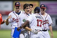 Bradley Keller (13) of the Danville Braves gets a hug from hitting coach Barbaro Garbey (17) following his game winning hit in the bottom of the 11th inning at American Legion Post 325 Field on June 25, 2017 in Danville, Virginia.  The Braves walked-off the Rays 7-6 in 11 innings.  (Brian Westerholt/Four Seam Images)