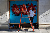 Artist Richshaad Ryan paints a mural on a boarded up window during a march against police brutality and racism in Washington, D.C. on Saturday, June 6, 2020.<br /> Credit: Amanda Andrade-Rhoades / CNP/AdMedia