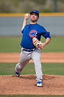 Chicago Cubs relief pitcher Corey Black (40) delivers a pitch to the plate during a Minor League Spring Training game against the Oakland Athletics at Sloan Park on March 13, 2018 in Mesa, Arizona. (Zachary Lucy/Four Seam Images)