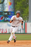 Charleston RiverDogs outfielder Austin Aune (22) during a game against the Augusta GreenJackets at Joseph P.Riley Jr. Ballpark on April 15, 2015 in Charleston, South Carolina. Charleston defeated Augusta 8-0. (Robert Gurganus/Four Seam Images)