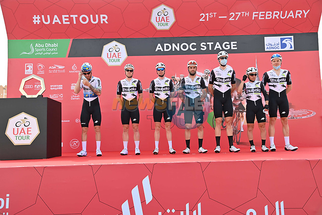 Team Qhubeka Assos at sign on before the start of Stage 1 of the 2021 UAE Tour the ADNOC Stage running 176km from Al Dhafra Castle to Al Mirfa, Abu Dhabi, UAE. 21st February 2021.  <br /> Picture: LaPresse/Gian Mattia D'Alberto | Cyclefile<br /> <br /> All photos usage must carry mandatory copyright credit (© Cyclefile | LaPresse/Gian Mattia D'Alberto)
