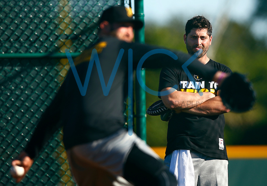 Francisco Cervelli #29 of the Pittsburgh Pirates watches bullpen sessions during spring training at Pirate City in Bradenton, Florida on February 17, 2016. (Photo by Jared Wickerham / DKPS)