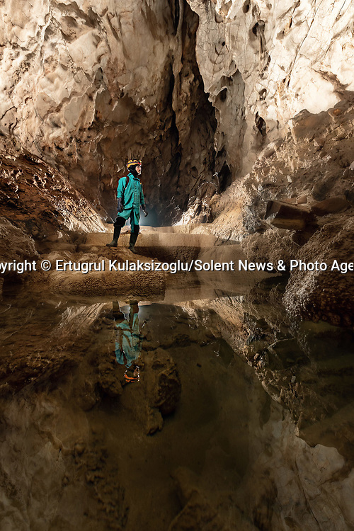 Pictured:   Kılıçlı Cave, Cide, Kastamonu.<br /> <br /> A team of explorers venture through a series of incredible caves filled with huge stalagmites and underwater lakes.<br /> <br /> The adventurers are carrying out tests in the subterranean world to work out how old the caves are and how they were formed.<br /> <br /> The intriguing images were captured in caves across Turkey by amateur photographer Ertuğrul Kulaksizoglu.   SEE OUR COPY FOR FULL DETAILS.<br /> <br /> <br /> Please byline: Ertugrul Kulaksizoglu/Solent News<br /> <br /> © Ertugrul Kulaksizoglu/Solent News & Photo Agency<br /> UK +44 (0) 2380 458800