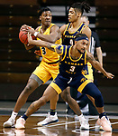 SIOUX FALLS, SD - MARCH 7: Tyree Eady #3 of the North Dakota State Bison looks for a teammate while being guarded by Brandon McKissic #3 and Zion Williams #0 of the UMKC Kangaroos during the Summit League Basketball Tournament at the Sanford Pentagon in Sioux Falls, SD. (Photo by Richard Carlson/Inertia)