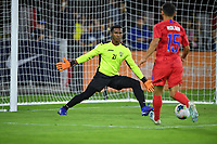 WASHINGTON, D.C. - OCTOBER 11: GK Nelson Johnston #21 of Cuba defends his goal against an advancing Cristian Roldan #15 of the United States during a Nations League match between USA and Cuba at Audi Field, on October 11, 2019 in Washington D.C.