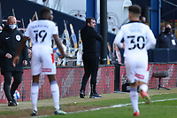 4th May 2021; Kenilworth Road, Luton, Bedfordshire, England; English Football League Championship Football, Luton Town versus Rotherham United; Luton Town Manager Nathan Jones watches the game closely