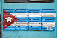 Cuba, Havana.  Cuban Flag Painted On Side of Building as Decoration, Central Havana.