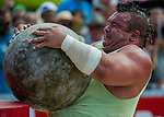 HAINAN ISLAND, CHINA - AUGUST 24:  Mike Jenkins of USA competes at the Atlas Stones event during the World's Strongest Man competition at Yalong Bay Cultural Square on August 24, 2013 in Hainan Island, China.  Photo by Victor Fraile