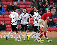 Pictured: Angel Rangel of Swansea (2nd L celebrating his equaliser with team mates L-R Danny Graham, Andrea Orlandi and Wayne Routledge. Saturday 07 January 2012<br /> Re: FA Cup football Barnsley FC v Swansea City FC at the Oakwell Stadium, south Yorkshire.