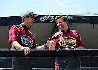 Jun. 17, 2011; Bristol, TN, USA: NHRA top fuel driver Larry Dixon (left) and teammate Del Worsham during qualifying for the Thunder Valley Nationals at Bristol Dragway. Mandatory Credit: Mark J. Rebilas-