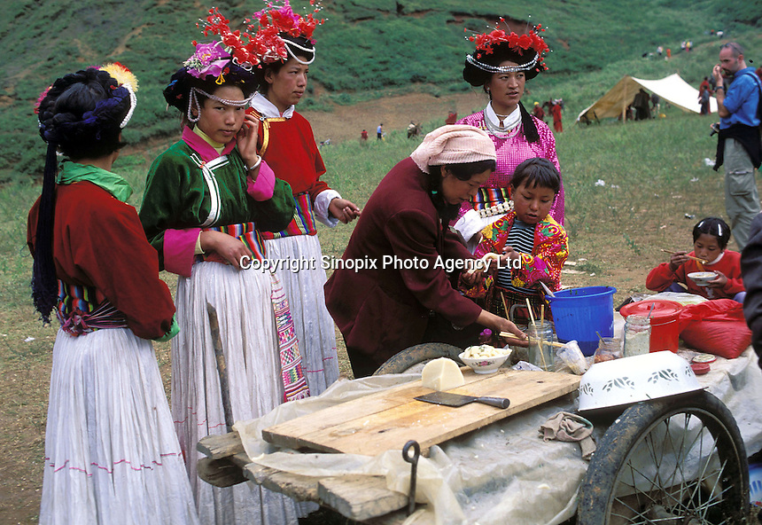 """Mosuo women at the fertility festival dedicated to the god Ganmo. Despite greater exposure to outside influence, the Mosuo women are confident their traditions will endure. Women from the Mosuo tribe do not marry, take as many lovers as they wish and have no word for """"father"""" or """"husband"""". But the arrival of tourism and the sex industry is changing their culture...PHOTO BY SINOPIX"""