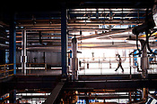 Employees in the Unit 1 of the Adani Power plant which produces 330MW power in Mundra port industrial city of Gujarat, India. Indian power companies have handed out dozens of major contracts to Chinese firms since 2008. Adani Power Ltd have built elaborate Chinatowns to accommodate Chinese workers, complete with Chinese chefs, ping pong tables and Chinese television. Chinese companies now supply equipment for about 25% of the 80,000 megawatts in new capacity.