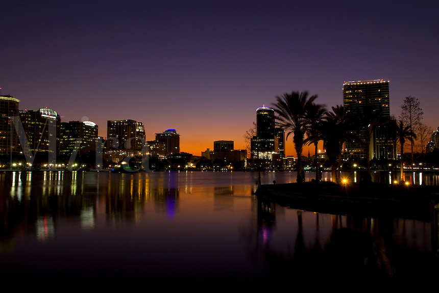 Orlando Florida skyline at night exposure from Lake Eola and skyscrapers at dusk for tourism 2009