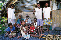 Portrait of a family gathered outside their home, Sulphur Bay Village, Ipekel Ipeukel, Tanna Island, Vanuatu.