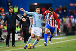 Facundo Roncaglia (l) of RC Celta de Vigo fights for the ball with Fernando Torres of Atletico de Madrid during their La Liga match between Atletico de Madrid and RC Celta de Vigo at the Vicente Calderón Stadium on 12 February 2017 in Madrid, Spain. Photo by Diego Gonzalez Souto / Power Sport Images