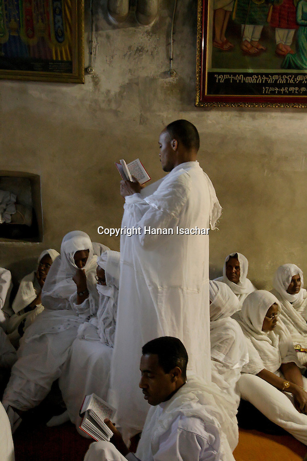 Israel, Jerusalem Old City. Ethiopian pilgrims praying at the Ethiopian Chapel at the Church of the Holy Sepulchre on Holy Saturday, Easter 2006<br />