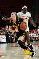 COLLEGE PARK, MD - FEBRUARY 13: Makenzie Meyer #3 of Iowa paces past Ashley Owusu #15 of Maryland during a game between Iowa and Maryland at Xfinity Center on February 13, 2020 in College Park, Maryland.