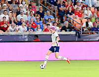 HOUSTON, TX - JUNE 10: Megan Rapinoe #15 of the United States brings the ball up the field during a game between Portugal and USWNT at BBVA Stadium on June 10, 2021 in Houston, Texas.