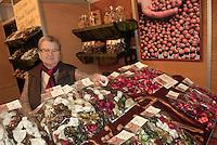 - truffle market in Alba, seller of hazelnut sweetses ....- mercato dei tartufi ad Alba, venditrice di dolci alla nocciola
