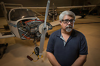 A portrait of Aviation Maintenance Technology Assistant Professor David Helmso  at UAA's Aviation Technology Complex on Merrill Field.