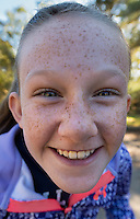 Smiling tween girl poses for a selfie.