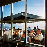 Tourists eat ice cream in a cafe at Lizard Point in Cornwall.