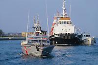 - Coast Guard patrol boat in the port of Brindisi....- motovedetta della Guardia Costiera s nel porto di Brindisi