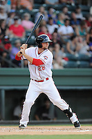 First baseman Sam Travis (28) of the Greenville Drive bats in a game against the Charleston RiverDogs on Thursday, August 21, 2014, at Fluor Field at the West End in Greenville, South Carolina. Travis is a second-round pick of the Boston Red Sox in the 2014 First-Year Player Draft out of Indiana University. Charleston won, 12-0. (Tom Priddy/Four Seam Images)