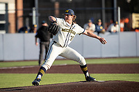 Michigan Wolverines pitcher Jack White (30) delivers a pitch to the plate against the Michigan State Spartans on March 21, 2021 in NCAA baseball action at Ray Fisher Stadium in Ann Arbor, Michigan. Michigan scored 8 runs in the bottom of the ninth inning to defeat the Spartans 8-7. (Andrew Woolley/Four Seam Images)