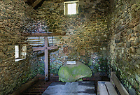 Interior of a rustic spring house votive chapel.