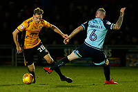 Mickey Demetriou of Newport County is tackled by Mark Connolly of Crawley Town during the Sky Bet League Two match between Newport County and Crawley Town at Rodney Parade, Newport, Wales, UK. 19 January 2018