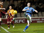 Motherwell v St Johnstone..30.12.15  SPFL  Fir Park, Motherwell<br /> Chris Kane and Stephen McManus<br /> Picture by Graeme Hart.<br /> Copyright Perthshire Picture Agency<br /> Tel: 01738 623350  Mobile: 07990 594431