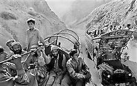 Afghan refugees returning from Pakistan with all their belongings on lorries endure travel through the notoriously dangerous Khyber pass on July 6 2002. More than six million people fled Afghanistan during the years of conflict following the Soviet invasion in 1979.