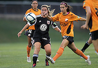 BOYDS, MARYLAND-JULY 07,2012:  Hayley Siegel (12) of DC United Women goes for a loose ball with Larissa Najjar (9) of Dayton Dutch Lions during a W League game at Maryland Soccerplex, in Boyds, Maryland. DC United women won 4-1.
