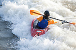 Kayaking the whitewater at Brennan's Wave on the Clark Fork River in Missoula, Montana