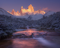 The first light of day illuminates Mt. Fitz Roy on a cold, snowy morning.<br />