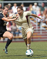 Boston College forward Victoria DiMartino (1) on the attack encounters stiff defense, University of Central Florida defender Noel Crane (24). After two overtime periods, Boston College tied University of Central Florida, 2-2, at Newton Campus Field, September 9, 2012.
