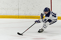 WORCESTER, MA - FEBRUARY 08: Emma Lange #16 of Holy Cross clears the puck during a game between Boston University and College of the Holy Cross at Hart Center Rink on February 08, 2020 in Worcester, Massachusetts.