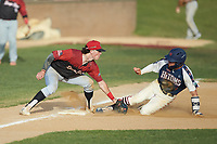 Jeremy Simpson (9) (Catawba) of the High Point-Thomasville HiToms is tagged out by Cort Maynard (5) (North Carolina Central University) of the Deep River Muddogs as he attempts to steal third base at Finch Field on June 27, 2020 in Thomasville, NC.  The HiToms defeated the Muddogs 11-2. (Brian Westerholt/Four Seam Images)