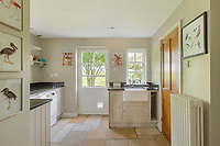 BNPS.co.uk (01202) 558833. <br /> Pic: Savills/BNPS<br /> <br /> Pictured: Utility room. <br /> <br /> A wheely rare opportunity...<br /> <br /> A grand country manor with a 300-year-old donkey wheel is on the market for £4.95m.<br /> <br /> The donkey wheel at Annables Manor, one of only two still in existence in England, was built in the 17th century and used to draw water from the 145ft well.<br /> <br /> The Grade II listed manor house near Harpenden, Herts, is one of the finest country houses in the area and as well as its unusual historic feature it has a heated swimming pool and tennis court in its 5.34 acres of land.<br /> <br /> The seven-bedroom home has lots of impressive features including oak beams, open fireplaces and solid oak floors.