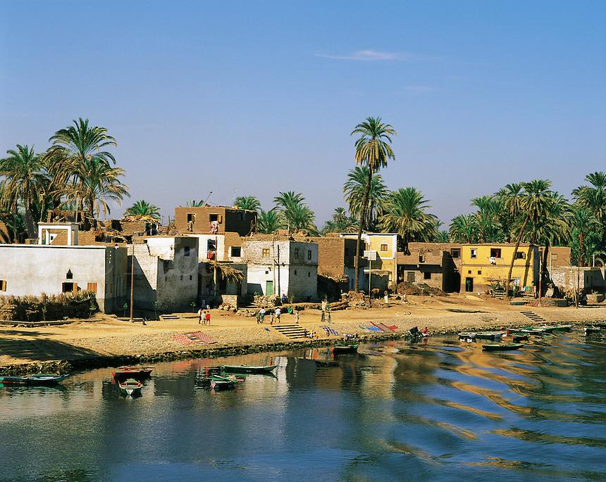 Riverbank village on the Nile near Luxor, Egypt, washing,