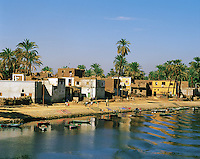 Riverbank village on the Nile near Luxor, Egypt, washing,