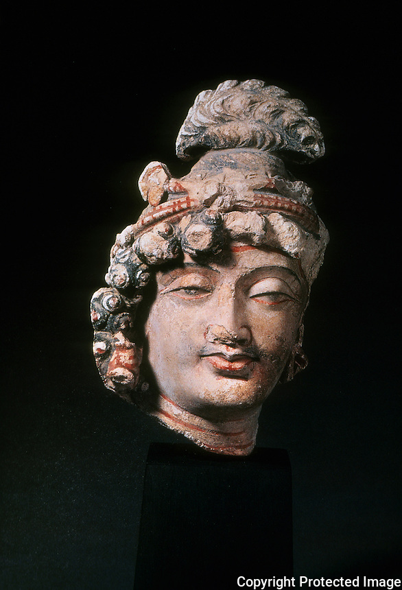 "India: Head of Bodhisattva. Stucco, with color, 10 3/4 in., Afghanistan.  ""Compassion and sympathy for human frailties"" .  PAL.  INDIAN SCULPTURE. Gupta Age--4th-5th Century A.D."