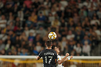 CARSON, CA - SEPTEMBER 15: Roger Espinoza #17 of Sporting Kansas City heads a ball during a game between Sporting Kansas City and Los Angeles Galaxy at Dignity Health Sports Complex on September 15, 2019 in Carson, California.