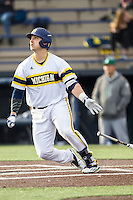 Michigan Wolverines catcher Harrison Wenson (7) follows through on his swing against the Eastern Michigan Hurons on May 3, 2016 at Ray Fisher Stadium in Ann Arbor, Michigan. Michigan defeated Eastern Michigan 12-4. (Andrew Woolley/Four Seam Images)