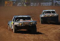 Apr 16, 2011; Surprise, AZ USA; LOORRS driver Kyle Leduc (99) leads Todd Leduc (4) during round 3 at Speedworld Off Road Park. Mandatory Credit: Mark J. Rebilas-.