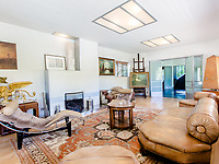 BNPS.co.uk (01202) 558833<br /> Pic: Savills/BNPS<br /> <br /> Pictured: Living room.<br /> <br /> A controversial and iconic country house that appeared in TV's Poirot is on the market for £2.5m.<br /> <br /> The quirky Y-shaped High and Over was met with disdain from the public and local planners when it was built in 1929-31.<br /> <br /> But the Grade II* listed building is now widely considered to be the first and finest house built in the Modernist style in Britain.<br /> <br /> The six-bedroom property in Amersham, Bucks, was also used in ITV's Poirot as the home of villain Henry Reedburn in The King of Clubs.
