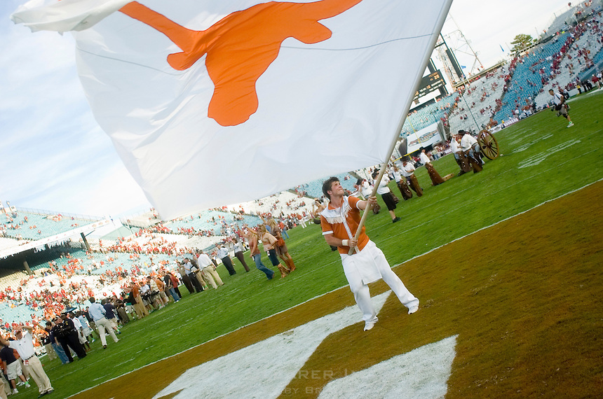 07 October 2006: A Texas cheerleader waves a Longhorn flag after the University of Texas' 28-10 victory over the University of Oklahoma Sooners at the Cotton Bowl in Dallas, TX.